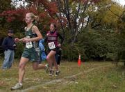 Free State&#39;s Kyra Kilwein, left, runs near the one-mile marker at the Class 6A regional meet. Stamm finished third and Kilwein took fourth during Saturday&#39;s race in Topeka.