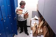 Sandy Helmert, evidence custodian for the Lawrence Police Department, is responsible for checking in and logging evidence collected by Lawrence officers. Once the evidence is turned in, there is a log of who checks it out if it leaves the evidence room for testing or other needs.