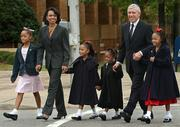 Secretary of state Condoleezza Rice, second from left, and British Foreign Secretary Jack Straw walk with, from left, Kimya Loder, 9, Candace Knight, 6, Kamaya Loder, 5, and Carmen Knight, 7, as they leave the 16th Street Baptist Church. The church was bombed in 1963, killing four young girls.