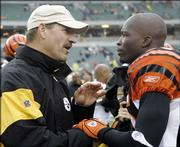 Pittsburgh coach Bill Cowher, left, talks to Cincinnati wide receiver Chad Johnson after their game. The Steelers beat the Bengals, 27-13, Sunday in Cincinnati.