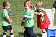 Hobbits Andrew Wallen, left, Walker Koberlein, center, and Christopher Nelson laugh during a water break Saturday at Youth Sports Inc.