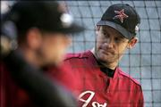 Houston Astros pitcher Roy Oswalt watches teammate Brandon Backe take batting practice. Oswalt is scheduled to start Game 3 of the World Series against the Chicago White Sox in Houston. Chicago leads the series, 2-0.
