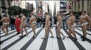 Sumo wrestlers, dressed in traditional mawashia, walk to a weigh-in before the World S.U.M.O. Challenge - Battle of the Giants at Madision Square Garden. The athletes, shown Oct. 22 in New York, are hoping to increase sumo wrestling's popularity in the U.S.