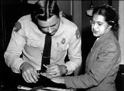 Rosa Parks is fingerprinted by Deputy Sheriff D.H. Lackey in Montgomery, Ala., on Feb. 22, 1956, two months after refusing to give up her seat on a bus for a white passenger on Dec. 1, 1955. Parks, whose refusal sparked the modern civil rights movement, died Monday. She was 92.