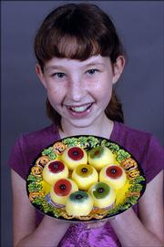 Hannah Fowler, a sixth-grader at Deerfield School, shown with Edible Eyeballs.