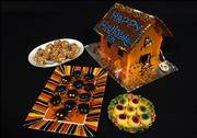 Teen board treats, shown clockwise from top left, are Butterfinger Popcorn Balls, Haunted House, Edible Eyeballs and Spider cookies.