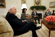 Vice President Dick Cheney, left, smiles Wednesday as he joins President Bush, far right, during a meeting with Zalmay Khalilzad,  U.S. ambassador to Iraq, second from right, and Secretary of State Condoleezza Rice in the Oval Office of the White House in Washington.