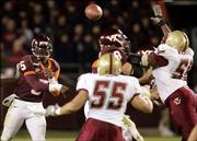 Virginia Tech's Marcus Vick (5) unloads a pass during the fourth quarter of a 30-10 victory over Boston College. Tech won Thursday in Blacksburg, Va.