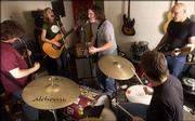 Members of Dead Girls Ruin Everything practice with Julia Peterson, second from left, Tuesday evening in preparation for a Neil Young Tribute Show. The band includes Cameron Hawk, left, JoJo Longbottom, center, Nick Colby and Eric Melin.