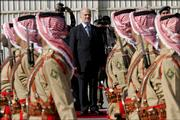 Iraqi Prime Minister Ibrahim Al-Jaafari, center, reviews a Jordanian guard of honor as he arrives Thurs-day at Amman Airport, Jordan. Al-Jaafari arrived on his first trip to Jordan to boost political, security and economic cooperation.