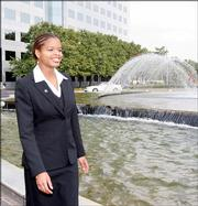 Yemaya Stallworth, an engineer at General Electric Co. in Atlanta and Clark Atlanta University student, walks Oct. 20 in the fountain area of the complex during a break. The black university has decided to eliminate the engineering department in May 2008 as part of a cost-cutting move at financially troubled Clark Atlanta. The department is Georgia's only black engineering program.