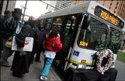 Riders board the Rosa Parks Memorial Bus as it stops Thursday on Woodward Avenue in Detroit. Parks' refusal to give up her bus seat to a white man in Montgomery, Ala., in 1955 led to a 381-day boycott of the city's bus system and helped spark the modern civil rights movement. She died Monday in Detroit at age 92.