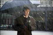 "Nicolas Cage plays TV forecaster Dave Spritz with equal parts depression and hilarity in ""The Weather Man."""