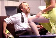 "Bruce, played by Will Paulson, gets seduced by Brooke, played by Kate Giessel, in the University Theatre production of Ben Elton&squot;s ""Popcorn."" The R-rated production sports sex, violence, explicit language and humor."