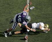 Kansas State linebacker Ted Sims (45) falls on the ball after forcing Colorado quarterback Joel Klatt to fumble in the second quarter. The Buffaloes held off the Wildcats, 23-20, Saturday in Manhattan, giving CU the outright lead in the Big 12 North race.