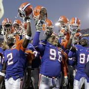 Florida players celebrate their victory over Georgia. The Gators beat the Bulldogs, 14-10, Saturday in Jacksonville, Fla.