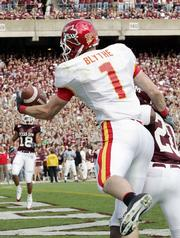 Iowa State's Todd Blythe snags a touchdown pass with one hand. Blythe had four TD catches in the Cyclones' 42-14 romp over Texas A&M on Saturday in College Station, Texas.