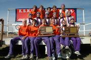 The Baldwin High cross country teams show off their state-championship trophies. Baldwin won the Class 4A boys and girls titles Saturday in Wamego.