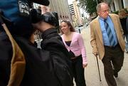Former Dover, Pa., school board member Bill Buckingham, right, is escorted by a supporter as he leaves the Federal Courthouse on Thursday in Harrisburg, Pa. Buckingham, a former school board member, denied advocating that creationism be taught alongside evolution until lawyers in a courtroom played a news clip that recorded him making such a comment.