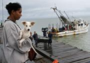 Merry Lopez, 29, evacuee of Cayo Miskitu, arrives Saturday on the wharf of Puerto Cabezas. Nicaragua issued a hurricane warning for its Caribbean coast and evacuated thousands as forecasters predicted the hurricane would strengthen before hitting Central America.
