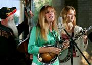 Members of the bluegrass band Cherryholmes perform during a CD release party at BMI Music in Nashville, Tenn. The band was named Entertainer of the Year on Thursday at the International Bluegrass Music Assn. Awards. From left are Jere, Sandy and Cia Cherryholmes.