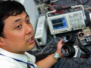 Taro Maeda, senior research scientist at the Nippon Telegraph and Telephone Corp. research center in Atsugi, near Tokyo, works with equipment used as a remote control for humans.
