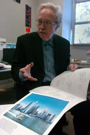 Peter Pran, a Kansas University professor, displays renderings of two towering residential buildings in Singapore that he helped to design.