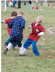 Hurricane Jacob Unruh, left, competes with Bobcat Jack Edmonds, right, for a 50-50 ball Saturday at Youth Sports Inc.