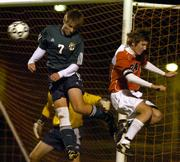 Free State High defender Brian Bracciano (7) breaks up an opportunity for Olathe East midfielder Keith Parkhurst in the first half of the Firebirds' 5-2 soccer loss to the Hawks. Olathe East won the state quarterfinal match Tuesday night at the College Boulevard Activities Center in Olathe.