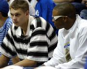 Minnesota high school standout Cole Aldrich, left, sits with former KU recruit C.J. Henry during Late Night in the Phog. Aldrich is expected to announce his oral commitment to Kansas University's basketball team today.