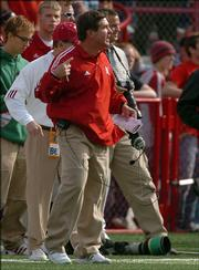 Nebraska coach Bill Callahan finishes a throat-slashing gesture during Nebraska's game with Oklahoma. Callahan was slapped by the Big 12 Conference for the gesture, which he made Saturday in a 31-24 loss to Oklahoma in Lincoln, Neb.