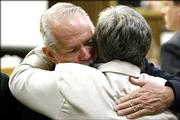 "Plaintiff Frederick ""Mike"" Humeston and his wife hug Thursday after Merck & Co. won a ruling in the battle over its Vioxx painkiller. The ruling means Merck won&squot;t be held liable for the 2001 heart attack suffered by Humeston while taking Vioxx."
