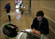 Massachusetts Institute of Technology graduate student Jose Expinosa, of Mexico City, works on his computer Thursday while connected to the school's wireless Internet in Cambridge, Mass. The school's newly upgraded wireless network covers the entire 9.4 million-square-foot campus.