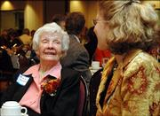 "Tensie Oldfather, left, talks with her daughter-in-law, Dyann Myers, of Stillwater, Minn., on Thursday during the Bert Nash fundraiser ""An Evening with Tensie Oldfather and Friends"" at the Lawrence Holidome."