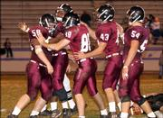 Members of the LHS defense celebrate a sack by Patrick Johnson, far left, in the second half.