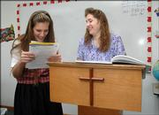 Mariel Pringle 14, a student at Heritage Baptist School, 1781 E. 800 Road, receives advice from her teacher Mary Bottrell, who supports the teaching of intelligent design. The State Board of Education is expected to approve science standards on Tuesday that will include intelligent design.