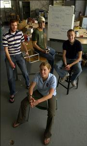 Members of the Kansas University Microgravity Team, clockwise from front, are team leader Loral O'Hara, a senior from Overland Park; Austin Pyle, a junior from Halstead; Zach Schauf, a junior from Newton; and Ben Parrott, a junior from Overland Park. In June, the team will test a satellite propulsion system it designed at the Johnson Space Center in Houston.