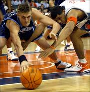 Utah Jazz forward Andrei Kirilenko, left, and Charlotte Bobcats forward Sean May dive for a loose ball. The Jazz won Monday night's overtime matchup in Charlotte, N.C.