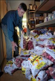 Emmett Mitchell, delivers one of dozens of bags of potatoes to the food pantry at the Salvation Army, 946 New Hampshire. United Methodist Men, a group of volunteers from Lawrence,  delivered 2,700 pounds of potatoes to 10 shelters and food kitchens in Lawrence Monday as part of a Northeast Kansas potato drop by the Methodist Church of Kansas.
