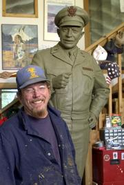 Sculptor Jim Brothers, Lawrence, sculpted a life-sized General Dwight D. Eisenhower that was placed in the United States Capitol in June of 2003. The original clay sculpture of the Eisenhower stands behind Brothers in his Lawrence studio. Three Kansas lawmakers want to further honor Eisenhower with a memorial near the National Mall in Washington, D.C.