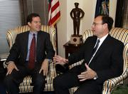 Supreme Court nominee Samuel Alito, right, speaks with Sen. Sam Brownback, R-Kan., Tuesday in Brownback's Capitol Hill office in Washington.