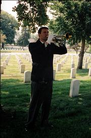 "Curtis Marsh performs ""taps"" during a funeral service this summer at the National Cemetery at Fort Leavenworth."