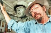 Jim Brothers, Lawrence, works on a sculpture for the National D-Day Memorial in Bedford, Va., in this 1999 file photo. Brothers has now been commissioned to create a bronze sculpture of a soldier lost in thought.