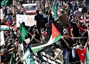 Thousands of Jordanians march during an anti-terrorism rally following Friday prayers in Amman, Jordan.