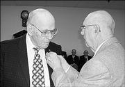 Benjamin Shore, left, receives a pin from John Diehl during a ceremony Oct. 10. Both were honored for serving 60 years as Masons by Lawrence Lodge No. 6.