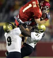 Iowa State's Todd Blythe makes a reception over Colorado's Gerett Burl (31) and Tom Hubbard (9). The Cyclones beat the Buffaloes, 30-16, Saturday night in Ames, Iowa.