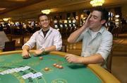 Jason Quattro, left, and Hugh Himmel play blackjack at the Borgata Casino in Atlanta City, N.J. Nevada is allowing the use of wireless, hand-held gambling devices inside of casinos and Atlantic City may follow suit.