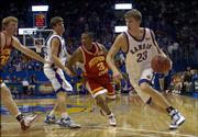 KU's Micah Downs drives against Pittsburg State's Marcus Madison in the second half.
