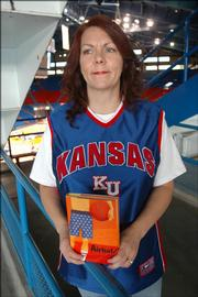 """In Lisa Harkrader&squot;s latest book, """"Airball,"""" a seventh-grader plots to meet a KU-turned-NBA basketball player who he believes is his father. The Tonganoxie author wrote the book under the pseudonym L.D. Harkrader."""