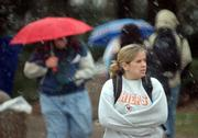 KU students face a bitter wind as they walk on campus in the first snow of the season Tuesday.